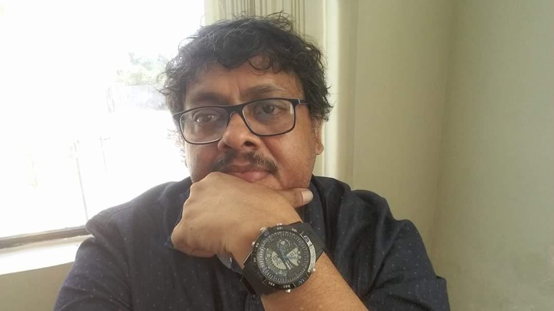 Dr. RAJIB BHAUMIK